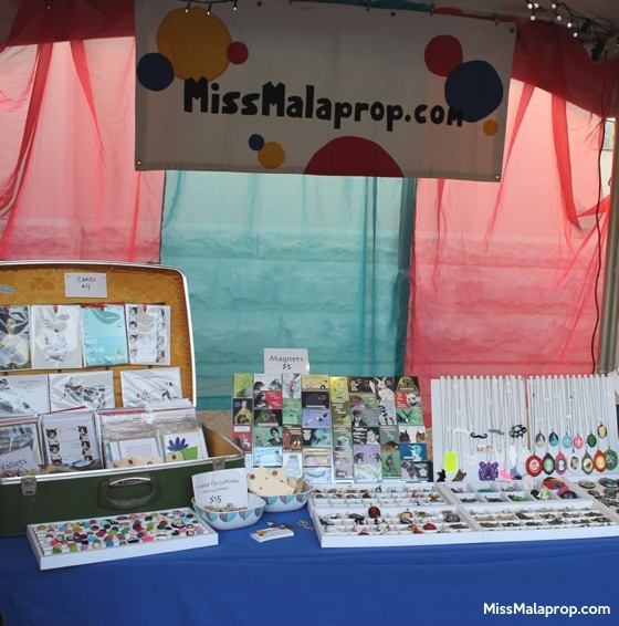 craft show booth display: Miss Malaprop at Gretna Fest